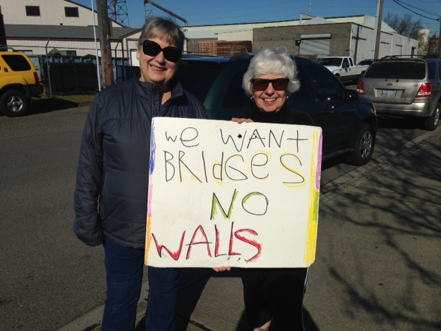 two women holding a protest sign